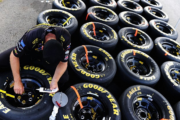 LONG POND, PA - AUGUST 05: A crew member of the #9 Stanley Ford, driven by Marcos Ambrose, glues a lug nut to a wheel before the start of the NASCAR Sprint Cup Series Pennsylvania 400 at Pocono Raceway on August 5, 2012 in Long Pond, Pennsylvania. (Photo by Patrick Smith/Getty Images for NASCAR)