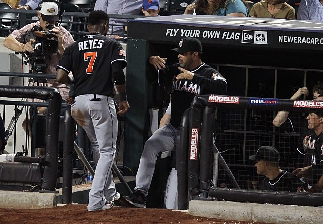 NEW YORK, NY - AUGUST 07: Jose Reyes #7 of the Miami Marlins celebrates with manager Ozzie Guillen #13 after scoring on Giancarlo Stanton #27 sacrifice fly in the fourth-inning against the New York Mets at CitiField on August 7, 2012 in the Flushing neighborhood of the Queens borough of New York City. (Photo by Mike Stobe/Getty Images)