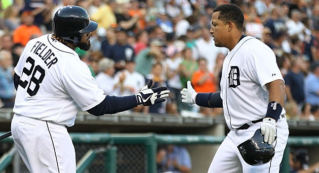 DETROIT, MI - AUGUST 07: Miguel Cabrera #24 of the Detroit Tigers celebrates with teammate Prince Fielder #28 after hitting a solo home run to left field during the fourth of the game against the New York Yankees at Comerica Park on August 7, 2012 in Detroit, Michigan. The Tigers defeated the Yankees 6-5. (Photo by Leon Halip/Getty Images)