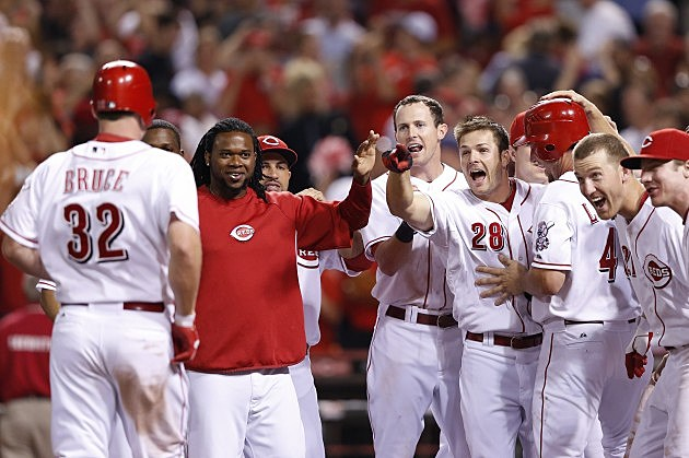 CINCINNATI, OH - AUGUST 14: Jay Bruce #32 of the Cincinnati Reds celebrates with teammates after hitting a three-run home run in the ninth inning of the game against the New York Mets at Great American Ball Park on August 14, 2012 in Cincinnati, Ohio. The Reds won 3-0. (Photo by Joe Robbins/Getty Images)