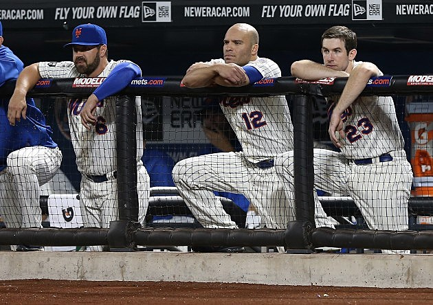 NEW YORK, NY - AUGUST 21: Kelly Shoppach #3,Scott Hairston #12 and Mike Baxter #23 of the New York Mets watch the last out of the game against the Colorado Rockies on August 21, 2012 at Citi Field in the Flushing neighborhood of the Queens borough of New York City. (Photo by Elsa/Getty Images)