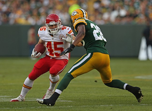 GREEN BAY, WI - AUGUST 30: Nate Eachus #45 of the Kansas City Chiefs tries to run against Sean Richardson #28 of the Green Bay Packers during a preseason game at Lambeau Field on August 30, 2012 in Green Bay, Wisconsin. (Photo by Jonathan Daniel/Getty Images)