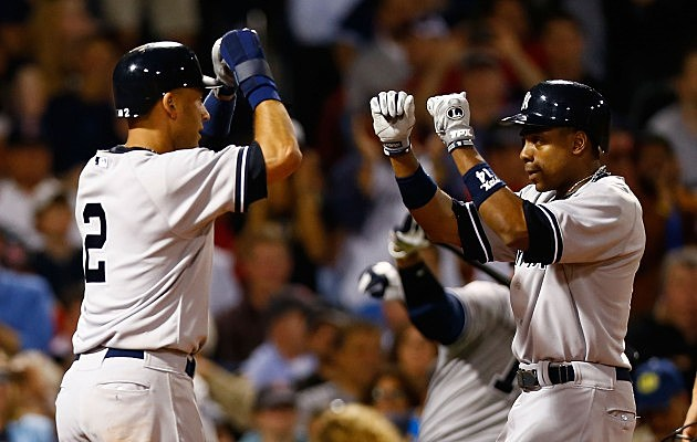 BOSTON, MA - SEPTEMBER 12: Curtis Granderson #14 of the New York Yankees is congratulated by teammate Derek Jeter #2 after hitting his second home run of the game in the 7th inning against the Boston Red Sox during the game on September 12, 2012 at Fenway Park in Boston, Massachusetts. (Photo by Jared Wickerham/Getty Images)