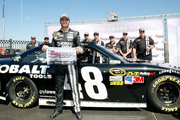 JOLIET, IL - SEPTEMBER 15: Jimmie Johnson, driver of the #48 Lowe's Kobalt Tools Chevrolet, poses with his pole award after he was the fastest driver during qualifying for the NASCAR Sprint Cup Series GEICO 400 at Chicagoland Speedway on September 15, 2012 in Joliet, Illinois. (Photo by Tyler Barrick/Getty Images)