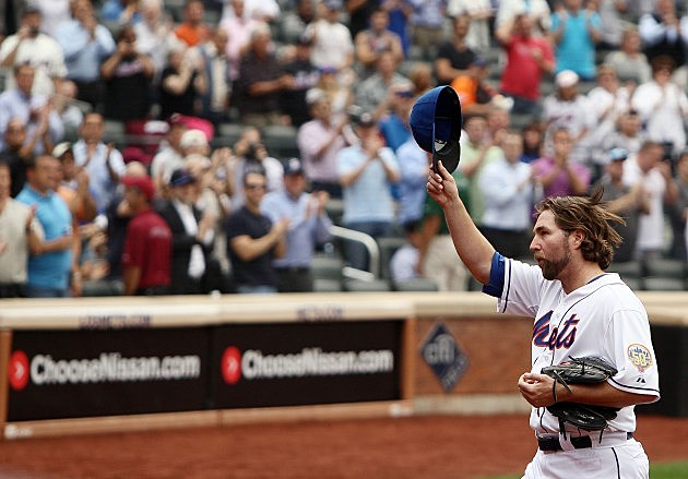 NEW YORK, NY - SEPTEMBER 27: R.A. Dickey #43 of the New York Mets acknowledges the crowd after being pulled in the eighth inning against the Pittsburgh Pirates at Citi Field on September 27, 2012 in the Flushing neighborhood of the Queens borough of New York City. (Photo by Alex Trautwig/Getty Images)