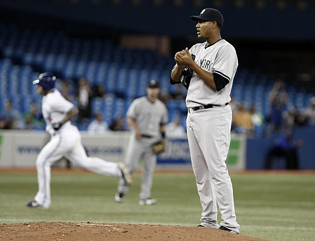 TORONTO, CANADA - SEPTEMBER 27: Ivan Nova #47 of the New York Yankees stands on the mound after giving up a two-run home run to Brett Lawrie of the Toronto Blue Jays during MLB action at the Rogers Centre September 27, 2012 in Toronto, Ontario, Canada. (Photo by Abelimages/Getty Images)