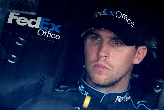 DOVER, DE - SEPTEMBER 28: Denny Hamlin, driver of the #11 FedEx Office Toyota, sits in his car in the garage area during practice for the NASCAR Sprint Cup Series AAA 400 at Dover International Speedway on September 28, 2012 in Dover, Delaware. (Photo by Jerry Markland/Getty Images for NASCAR)
