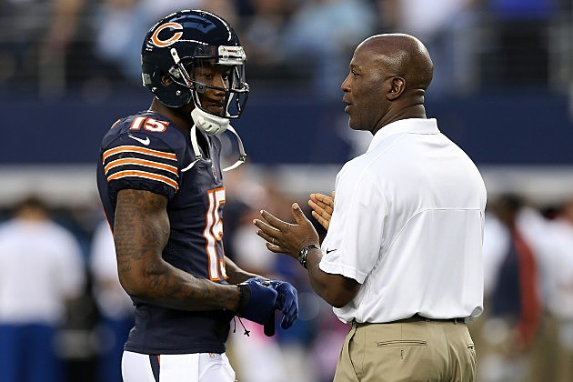 ARLINGTON, TX - OCTOBER 01: Brandon Marshall (L) #15 of the Chicago Bears talks with head coach Lovie Smith during warm ups against the Dallas Cowboys at Cowboys Stadium on October 1, 2012 in Arlington, Texas. (Photo by Ronald Martinez/Getty Images)