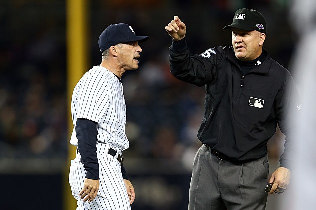 NEW YORK, NY - OCTOBER 14: Manager Joe Girardi of the New York Yankees is thrown out of the game by umpire Jeff Nelson out of the game in the eighth inning against the Detroit Tigers during Game Two of the American League Championship Series at Yankee Stadium on October 14, 2012 in the Bronx borough of New York City. (Photo by Elsa/Getty Images)