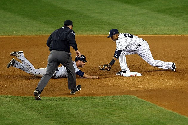 NEW YORK, NY - OCTOBER 14: Umpire Jeff Nelson calls Omar Infante #4 of the Detroit Tigers safe as he dove back into second base against Robinson Cano #24 of the New York Yankees in the top of the eighth inning during Game Two of the American League Championship Series at Yankee Stadium on October 14, 2012 in the Bronx borough of New York City. (Photo by Al Bello/Getty Images)