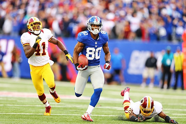 EAST RUTHERFORD, NJ - OCTOBER 21: Victor Cruz #80 of the New York Giants runs after a catch for the winning touchdown as Madieu Williams #41, and Josh Wilson #26 of the Washington Redskins give chase in the fourth quarter of a 27-23 Giant win at MetLife Stadium on October 21, 2012 in East Rutherford, New Jersey. (Photo by Al Bello/Getty Images)