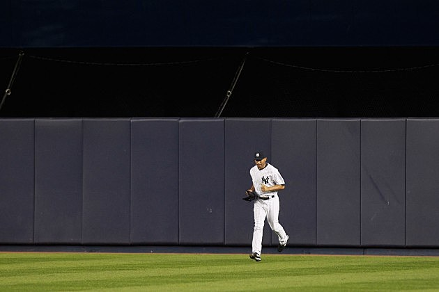 NEW YORK, NY - OCTOBER 06: Mariano Rivera #42 of the New York Yankees runs in from the bullpen across the outfield grass to pitch against the Detroit Tigers during Game Five of the American League Championship Series at Yankee Stadium on October 6, 2011 in the Bronx borough of New York City. (Photo by Nick Laham/Getty Images)