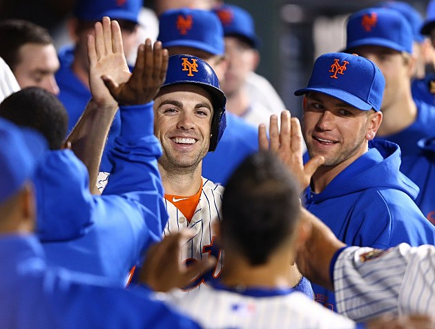 NEW YORK, NY - SEPTEMBER 26: David Wright #5 of the New York Mets celebrates with his teammates after passing Ed Kranepool as the New York Mets all time hits leader with 1419 during the third inning outfield their game on September 26, 2012 at Citi Field in the Flushing neighborhood of the Queens borough of New York City. (Photo by Al Bello/Getty Images)