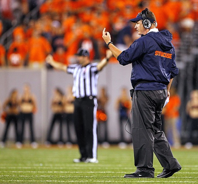 EAST RUTHERFORD, NJ - SEPTEMBER 08: Head coach Doug Marrone of the Syracuse Orange signals to his team against the USC Trojans in the second half during a game at MetLife Stadium on September 8, 2012 in East Rutherford, New Jersey. USC defeated Syracuse 42-29. (Photo by Rich Schultz/Getty Images)