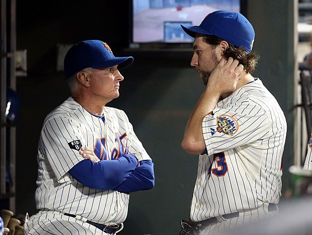 NEW YORK, NY - SEPTEMBER 17: R.A. Dickey #43 of the New York Mets talks with manager Terry Collins after the seventh inning against the Philadelphia Phillies at Citi Field on September 17, 2012 in the Flushing neighborhood of the Queens borough of New York City. (Photo by Jim McIsaac/Getty Images)