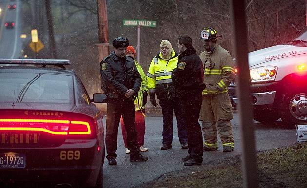 FRANKSTOWN TWP, PA - DECEMBER 21: Blair County Sheriffs Deputies stand at the road block in Blair County on December 21, 2012 in Frankstown Township, Pennsylvania. According to reports, a man shot and killed two men and one woman and injured three state troopers before being shot and killed by police along Juniata Valley Road in Frankstown Township. (Jeff Swensen/Getty Images)