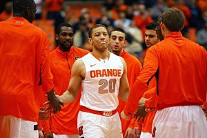 SYRACUSE, NY - NOVEMBER 25: Brandon Triche #20 of the Syracuse Orange high fives teammates as he enters the court prior to the game against the Colgate Raiders at the Carrier Dome on November 25, 2012 in Syracuse, New York. (Photo by Nate Shron/Getty Images)