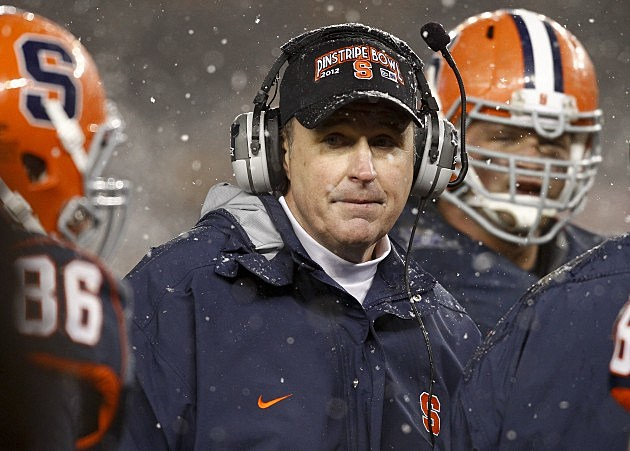 NEW YORK, NY - DECEMBER 29: Head coach Doug Marrone of the Syracuse Orange works on the sidelines against the West Virginia Mountaineers in the New Era Pinstripe Bowl at Yankee Stadium on December 29, 2012 in the Bronx borough of New York City. (Photo by Jeff Zelevansky/Getty Images)