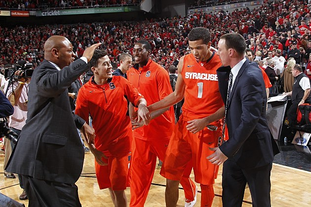 LOUISVILLE, KY - JANUARY 19: Michael Carter-Williams #1 of the Syracuse Orange celebrates with coaches and teammates after the game against the Louisville Cardinals at KFC Yum! Center on January 19, 2013 in Louisville, Kentucky. Syracuse defeated Louisville 70-68. (Photo by Joe Robbins/Getty Images)