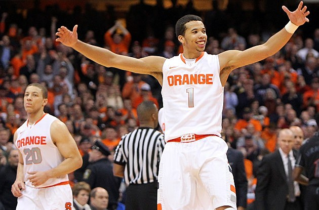 SYRACUSE, NY - JANUARY 21: Michael Carter-Williams #1 of the Syracuse Orange celebrates after a play during the game against the Cincinnati Bearcats at the Carrier Dome on January 21, 2013 in Syracuse, New York. (Photo by Nate Shron/Getty Images)