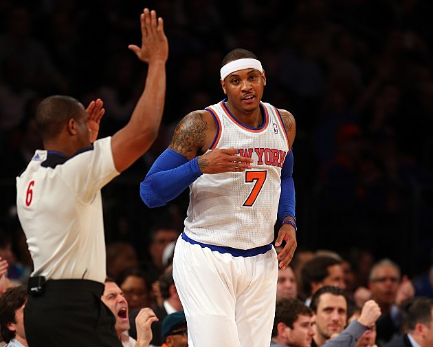 NEW YORK, NY - JANUARY 30: Carmelo Anthony #7 of the New York Knicks celebrates his three point basket in the first half against the Orlando Magic on January 30, 2013 at Madison Square Garden in New York City. NOTE TO USER: User expressly acknowledges and agrees that, by downloading and/or using this photograph, user is consenting to the terms and conditions of the Getty Images License Agreement. (Photo by Elsa/Getty Images)