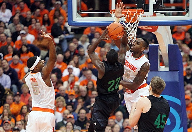SYRACUSE, NY - FEBRUARY 4: Jerian Grant #22 of the Notre Dame Fighting Irish puts the ball up to the basket with teamate Tom Knight #45 against Rakeem Christmas #25 and C.J. Fair #45 of the Syracuse Orange during the game at the Carrier Dome on February 4, 2013 in Syracuse, New York. (Photo by Nate Shron/Getty Images)