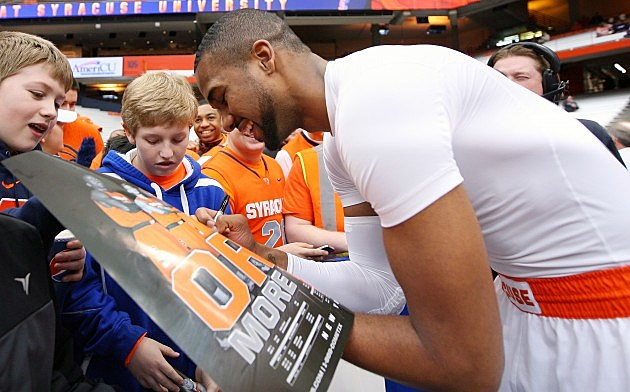 SYRACUSE, NY - FEBRUARY 10: James Southerland #43 of the Syracuse Orange signs autographs for fans prior to the game against the St. John's Red Storm at the Carrier Dome on February 10, 2013 in Syracuse, New York. (Photo by Nate Shron/Getty Images)