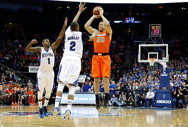 NEWARK, NJ - FEBRUARY 16: Brandon Triche #20 of the Syracuse Orange attempts a shot against Aaron Cosby #1 and Brandon Mobley #2 of the Seton Hall Pirates at Prudential Center on February 16, 2013 in Newark, New Jersey. (Photo by Chris Chambers/Getty Images)