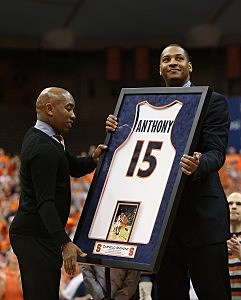 SYRACUSE, NY - FEBRUARY 23: Former Syracuse Orange player Carmelo Anthony (R) receives his jersey from athletic director Daryl Gross (L) as his number is retired during a ceremony at half time during the game against the Georgetown Hoyas at the Carrier Dome on February 23, 2013 in Syracuse, New York. (Photo by Nate Shron/Getty Images)