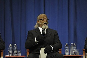HEMPSTEAD, NY - OCTOBER 18: Jimmy McMillan of the Rent is 2 Damn High Party, running for New York State Governor, speaks during the gubernatorial debate at Hofstra University October 18, 2010 in Hempstead, New York. The two main candidates, Andrew Cuomo and Carl Paladino, appeared onstage with candidates Kristen Davis of the Anti-Prohibition Party, Warren Redlich of the Libertarian Party, Howie Hawkins of the Green Party, Jimmy McMillan of the Rent is 2 Damn High Party, and Charles Barron of the Freedom Party. (Photo by Audrey C. Tiernan-Pool/Getty Images)