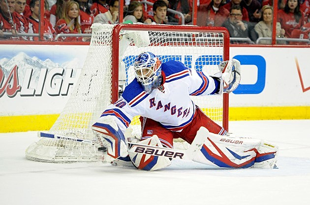 WASHINGTON, DC - MAY 13: Henrik Lundqvist #30 of the New York Rangers makes a save in the first period against the Washington Capitals in Game Seven of the Eastern Conference Quarterfinals during the 2013 NHL Stanley Cup Playoffs at the Verizon Center on May 13, 2013 in Washington, DC. (Photo by Greg Fiume/Getty Images)
