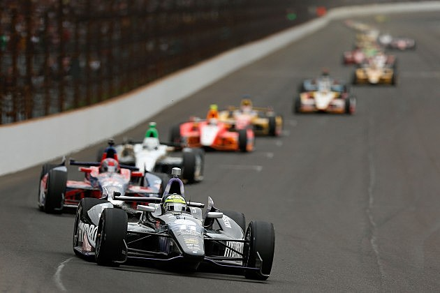 INDIANAPOLIS, IN - MAY 26: Tony Kanaan of Brazil, driver of the Hydroxycut KV Racing Technology-SH Racing Chevrolet, leads a pack of cars during the IZOD IndyCar Series 97th running of the Indianpolis 500 mile race at the Indianapolis Motor Speedway on May 26, 2013 in Indianapolis, Indiana. (Photo by Chris Graythen/Getty Images)