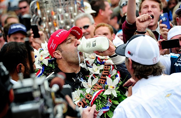 INDIANAPOLIS, IN - MAY 26: Tony Kanaan of Brazil, driver of the Hydroxycut KV Racing Technology-SH Racing Chevrolet, takes a sip of milk in victory lane as he celebrates winning the IZOD IndyCar Series 97th running of the Indianpolis 500 mile race at the Indianapolis Motor Speedway on May 26, 2013 in Indianapolis, Indiana. (Photo by Robert Laberge/Getty Images)