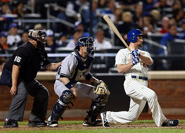 NEW YORK, NY - MAY 27: Daniel Murphy #28 of the New York Mets hits an RBI single in the eighth inning as Chris Stewart #19 of the New York Yankees catches on May 27, 2013 at Citi Field in the Flushing neighborhood of the Queens borough of New York City. Both the New York Mets and the New York Yankees are wearing special uniforms to commemorate Memorial Day. (Photo by Elsa/Getty Images)