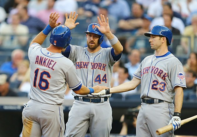 NEW YORK, NY - MAY 29: Rick Ankiel #16 and John Buck #44 celebrates scoring runs with Mike Baxter #23 of the New York Mets against the New York Yankees during their game on May 29, 2013 at Yankee Stadium in the Bronx borough of New York City (Photo by Al Bello/Getty Images)