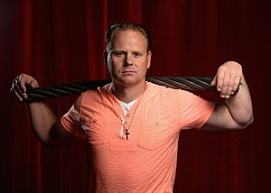 SARASOTA, FL - FEBRUARY 15: Nik Wallenda poses for a photograph with a piece of the high wire he used to walk over Niagara Falls on at Circus Sarasota on February 15, 2013 in Sarasota, Florida. Wallenda is planning to walk on a high wire over the Grand Canyon this summer. (Photo by Tim Boyles/Getty Images)