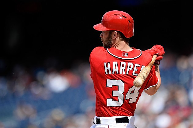 WASHINGTON, DC - JULY 07: Bryce Harper #34 of the Washington Nationals hits a single to center in the sixth inning of a game against the San Diego Padres at Nationals Park on July 7, 2013 in Washington, DC. (Photo by Patrick McDermott/Getty Images)