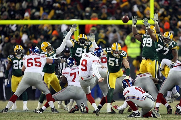 GREEN BAY, WI - JANUARY 20: Kicker Lawrence Tynes #9 of the New York Giants kicks a game winning 47-yard field goal to win the NFC championship game against the Green Bay Packers on January 20, 2008 at Lambeau Field in Green Bay, Wisconsin. The Giants defeated the Packers 23-20 in overtime to advance to the Superbowl XLII. (Photo by Jed Jacobsohn/Getty Images)