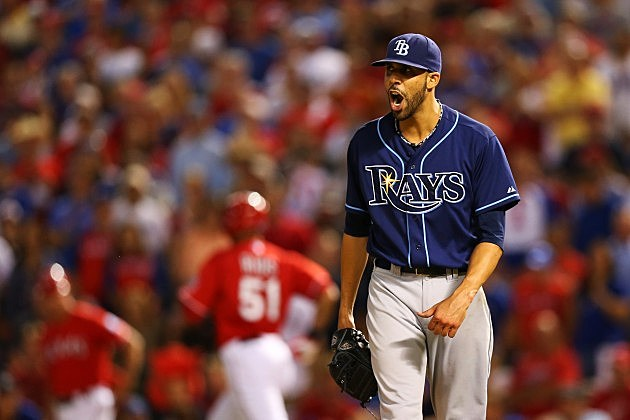 ARLINGTON, TX - SEPTEMBER 30: David Price #14 of the Tampa Bay Rays reacts after the final out of the eighth inning against the Texas Rangers during the American League Wild Card tiebreaker game at Rangers Ballpark in Arlington on September 30, 2013 in Arlington, Texas. (Photo by Ronald Martinez/Getty Images)
