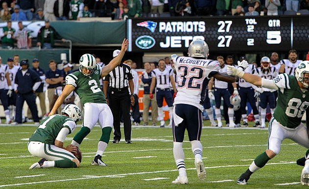 EAST RUTHERFORD, NJ - OCTOBER 20: Kicker Nick Folk #2 of the New York Jets hits the game winning field goal in overtime against the New England Patriots at MetLife Stadium on October 20, 2013 in East Rutherford, New Jersey. The Jets won 30-27. (Photo by Ron Antonelli/Getty Images)