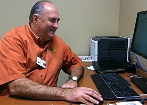 Bass Pro Shops General Manager Joe Chaney at his desk 10022013 by Kristine Bellino
