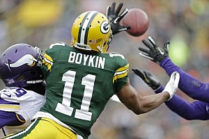 GREEN BAY, WI - NOVEMBER 24: Jarrett Boykin #11 of the Green Bay Packers battles for the ball with Xavier Rhodes #29 of the Minnesota Vikings at Lambeau Field on November 24, 2013 in Green Bay, Wisconsin. (Photo Tom Lynn /Getty Images)