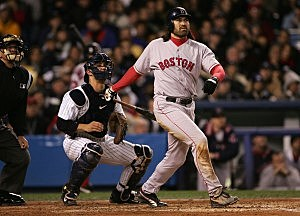 NEW YORK - OCTOBER 20: Johnny Damon #18 of the Boston Red Sox hits a grand-slam home run in the second inning against the New York Yankees during game seven of the American League Championship Series on October 20, 2004 at Yankee Stadium in the Bronx borough of New York City. (Photo by Doug Pensinger/Getty Images)