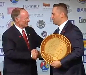 Remington CEO George Kollitides accepts seal of Alabama from Gov.