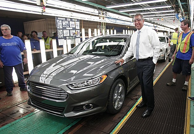 Flat Rock, MI - Joe Hinrichs, Ford's President of the Americas, poses with a Ford Fusion during a celebration of the first made-in-the-USA Ford Fusion coming off the assembly line at Ford Motor Company's Flat Rock Assembly Plant August 29, 2013 in Flat Rock, Michigan. Ford invested $555 million in the plant and added 1400 new employees to help produce the new Fusion in the United States. (Photo by Bill Pugliano/Getty Images)