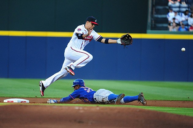 ATLANTA, GA - APRIL 10: Eric Young, Jr. #22 of the New York Mets steals second base against Ramiro Pena #14 of the Atlanta Braves at Turner Field on April 10, 2014 in Atlanta, Georgia. (Photo by Scott Cunningham/Getty Images) *** Local Caption ***  Eric Young, Jr.; Ramiro Pena