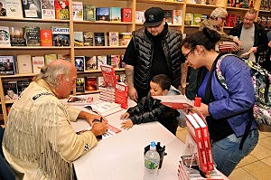 """Jesse Ventura Signs Copies Of """"63 Documents The Government Doesn't Want You To Read"""""""