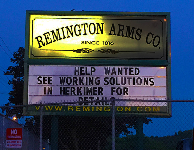 A sign at the entrance of the Remington Arms plant in Ilion, NY announces the nearly 200 year old plant is hiring.  (Photo by Bill Keeler / WIBX)