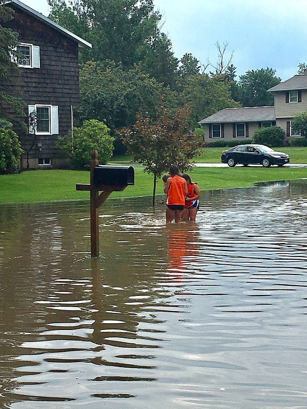Photo of flooding on Chateau Drive in Whitestown after thunderstorms hit the region on Monday, July 17, 2017. Photo by Rick Short)